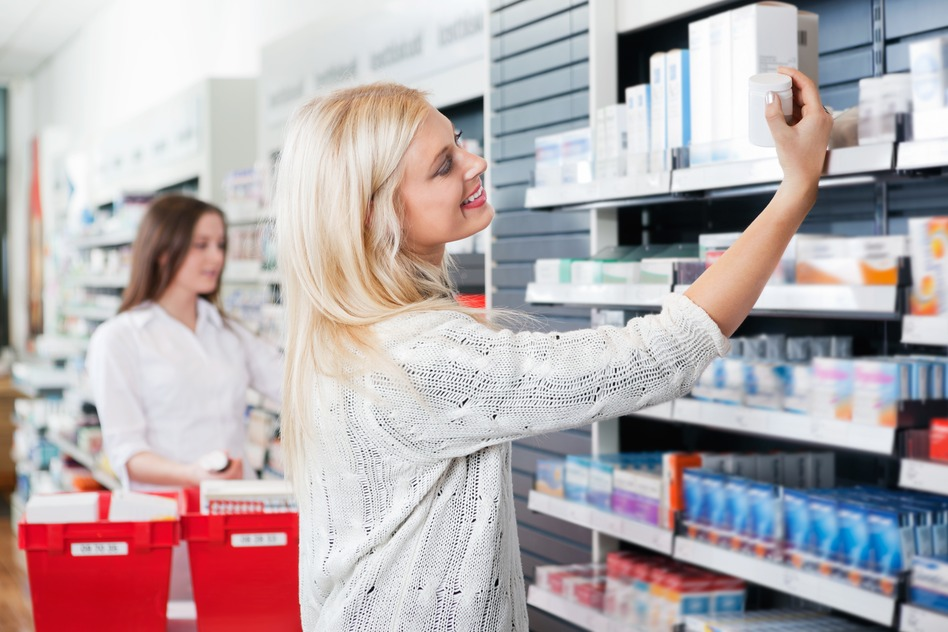 woman-buying-medicine-in-pharmacy