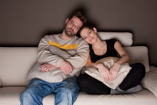 photodune-1457338-a-candid-photo-of-a-young-couple-watching-tv-xs