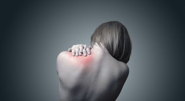 A woman with shoulder and neck pain