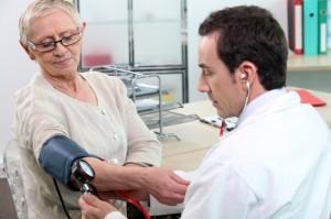 Older woman having her blood pressure taken