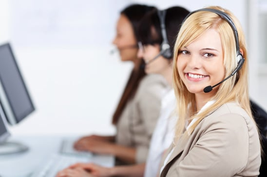 Young Customer Service Executive Wearing Headset In Office